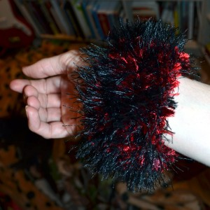 Wrist Cuff Knit from Bernat Boa in red and black, and black Lion Brand Fun Fur yarn